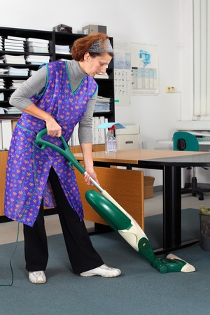 professional cleaning lady at her work in the office  Standard-Bild