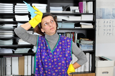 Tired professional cleaning lady at her work in the office  Stock Photo - 8965339