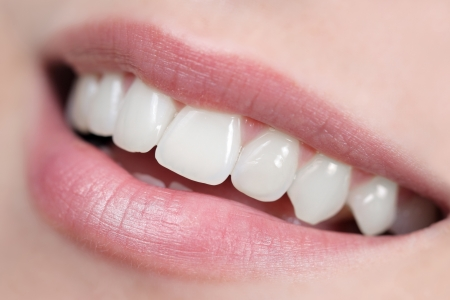 Close up of white, shiny and healthy smile. Intentional very shallow depth of field.