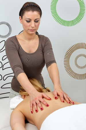 Beautiful young woman receiving professional massage  photo