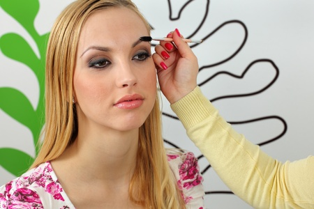 Eyebrows shaping in professional studio. photo