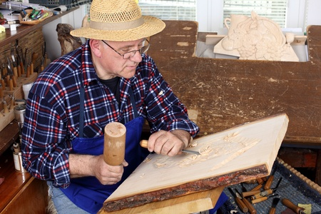 Woodcarver work in his workshop.