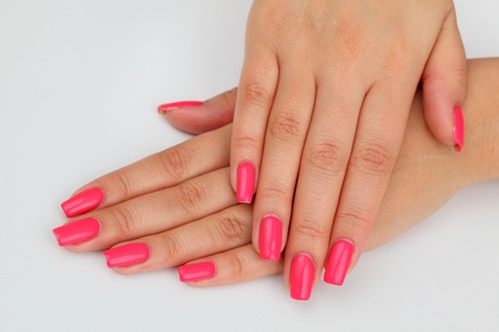 Beautiful hand with perfect red nail manicure. Standard-Bild