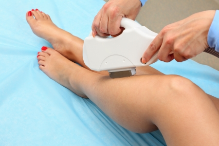 Laser hair removal on ladies legs. Intentional shallow depth of field.