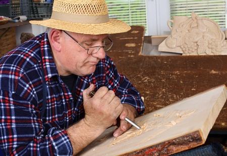 Woodcarver work in his workshop. photo