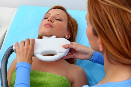 Laser hair removal from chin. Intentional shallow depth of field Stock Photo - 9601543