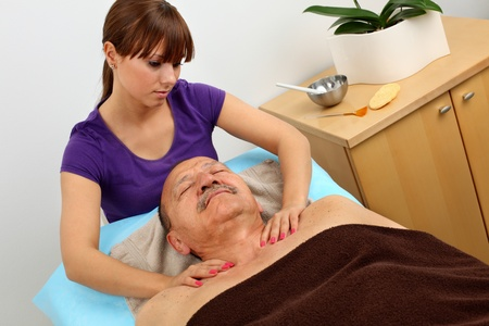 older man receiving professional massage Stock Photo