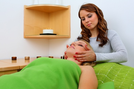 Beautiful young woman receiving professional massage  Stock Photo