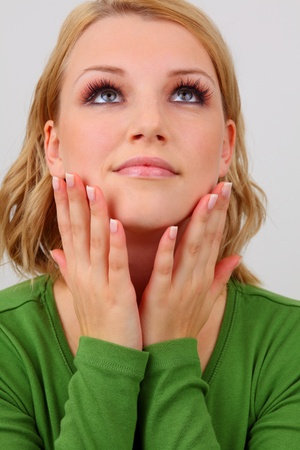 pretty young lady with beautiful makeup, long eyelashes and manicured nails  Standard-Bild