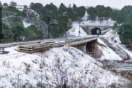 Train track covered by snow and ice. Exit of the tunnel frozen