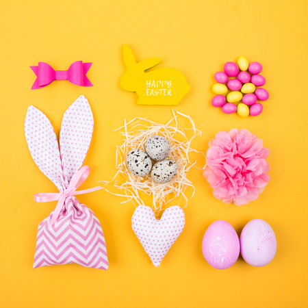 Flat lay stylish set pink and yellow easter eggs fabric bunny flat lay stylish set pink and yellow easter eggs fabric bunny gift bags with negle Images