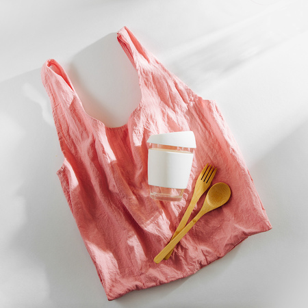 Eco friendly. Cloth shopping bag,  bamboo cutlery and  reusable coffee mug. Sustainable lifestyle.  Plastic free concept.