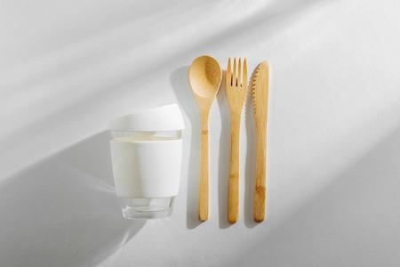 Eco friendly bamboo cutlery set and reusable coffee mug. Zero waste, plastic free concept. Stock Photo