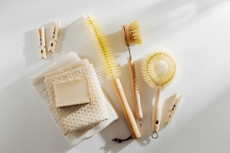 Zero waste, compostable cleaning tools. Wooden dish brush and clothespins. Eco friendly concept.