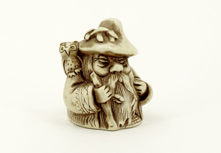 gnome: souvenirs gnome, gnome figurine with an owl on his shoulder.