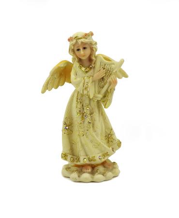 beatitude: Little angel figurine isolated on white background.