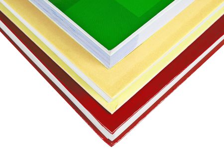 Stack of colorful books isolated on white background photo