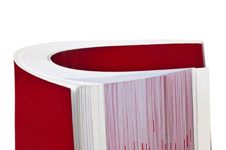 Rolled up book isolated on white background photo