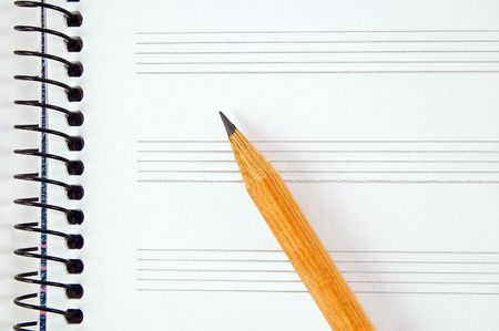 Blank music sheet and pencil