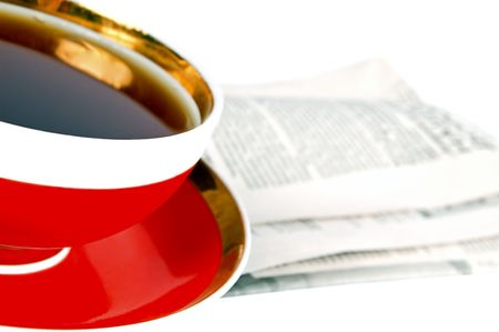 evening newspaper: A cup of tea and a newspaper