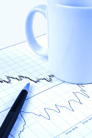 Pen and cup on Forex candlestick chart in blue lighting