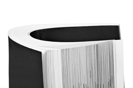 Rolled up black book isolated on white background photo