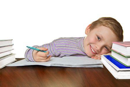 Smiling boy doing homework