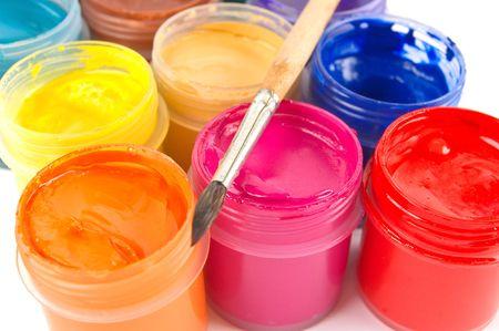 Multicolored gouache paints and paintbrush  Foto de archivo