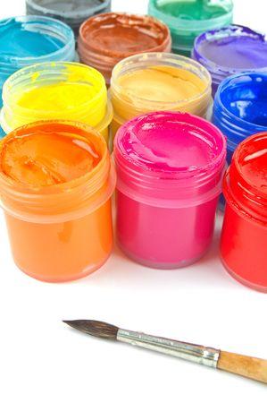 Multicolored gouache paints and paintbrush