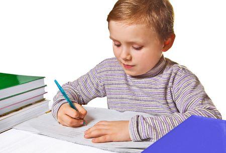 Boy doing homework, isolated on white background