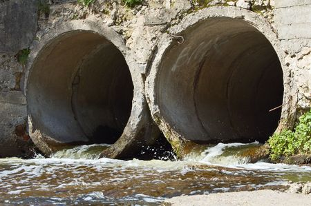 Water flowing out of two concrete drain  pipes. Stock Photo - 2950920