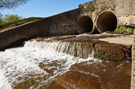 Water flowing out of two concrete drain  pipes. Stock Photo - 2950921