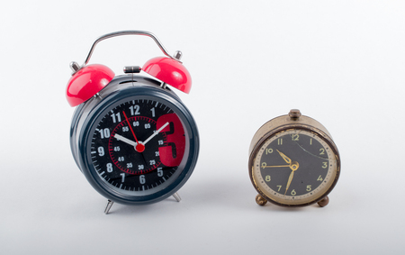 modern and antique alarm clock by the side separated