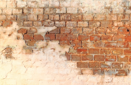 red brick wall with light and shadows