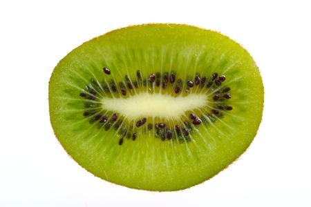 A single slice of kiwi fruit on a white background Stock Photo - 8992282