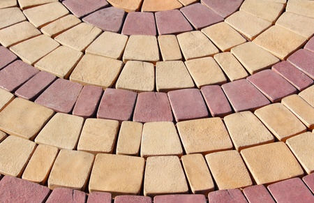 terrace of yellow and red stone paved radial