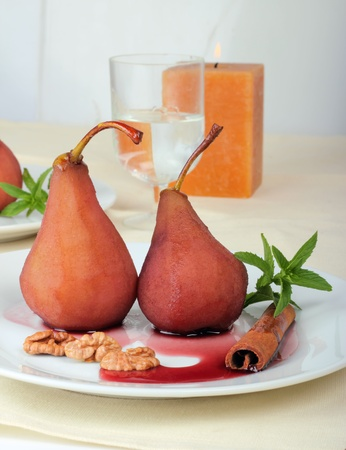 Dessert from pears in red wine and a syrup