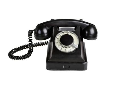 rotary dial telephone: Anticuado tel�fono aislado sobre un fondo blanco.