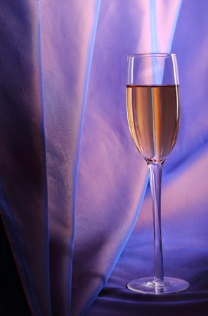 Celebratory glass of champagne on a dark blue background