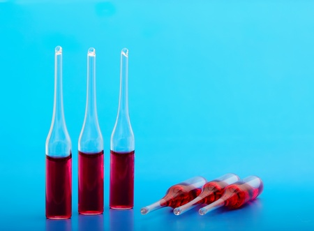 Medical ampoules on a blue background are closed Stock Photo - 12273565