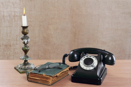 Still-life with old phone and a candlestick