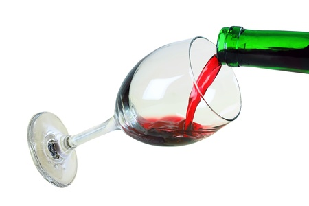 the glass with red wine is isolated on a white background