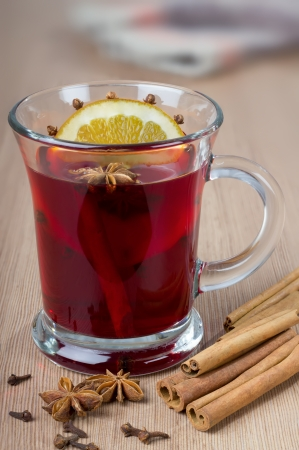 Fragrant mulled wine flavored with spices in a glass of orange.