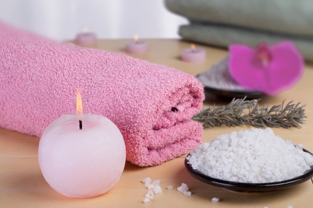 Aromatic spa set with sea salt and colored candles.