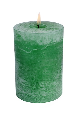 Large green burning candle.Isolated on white.
