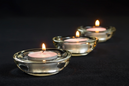 Three burning candles on black background. Stock Photo - 18660918