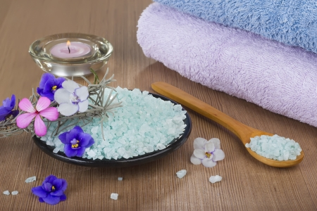 Aromatic spa set with sea salt and colored candles. photo