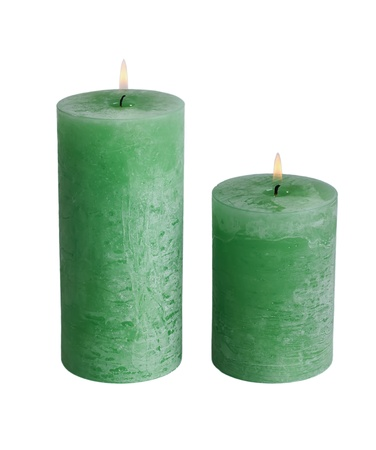 Large green burning candle.Isolated on white. photo