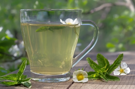 Mint tea with  green leaves served on the terrace Stock Photo