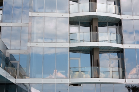 Sky reflection in the glass windows of high-rise buildings